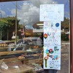 11-2012 Summer Olympic Torch Big Tidy Up Portway posters displayed by local shopkeepers