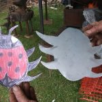 32-2013 Summer - local blacksmith uses children's designs for the tree guard