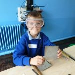 39-2013 Aut Portway pupil happily displays his label for the wood