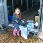 43-2013 Aut Another Portway pupil gives up her time in half-term and helps to mix wildflower seed for the meadow at Harmony Woods