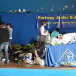 5-2012 Spr Waste Week - Sorting all the donations for recycling
