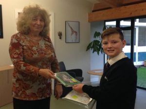 Handing over Applemore College's 51 Postcards to Paris to Gill Hickman