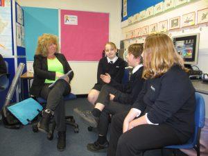 EcoTeam members describing their activities to Gill Hickman.