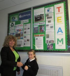 EcoTeam member Ami Prince being congratulated on achieving the Bronze Award by Gill Hickman.