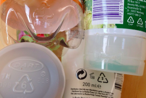 recycling codes and logos on plastic bottles