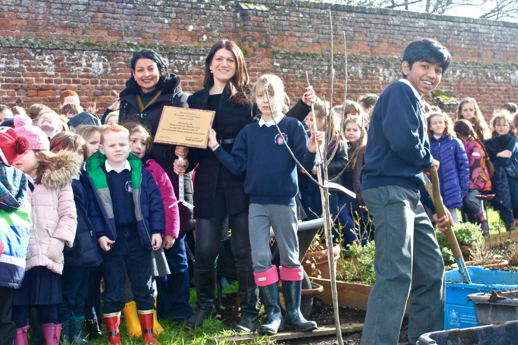 All the students did their part to help get the apple tree planted