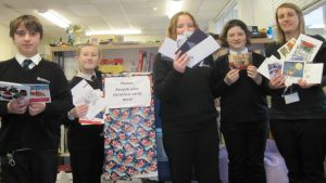 Eco Committee members and Miss Greenwood celebrating counting 5475 cards.