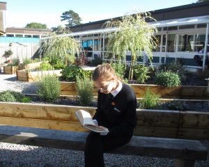 Year 10 student Brooke Howse enjoying time to read in the Quiet Quad.