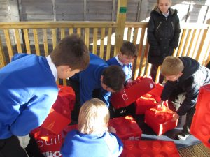 Wildground Junior School students racing to build the lego wall in the Quiet Quad shelter.