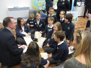 Students from St Luke's CofE Primary School, Sway reviewing their learning from the conference and planning to take action back at school and home, with Samuel Wood, Year 8 Applemore College mentor.