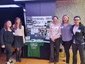Figure 1. The Salford University Stand (Left to Right) Rachael Fraser. Lori Moore, Ella Trickett, Natasha Woest, Sevim Yildiz