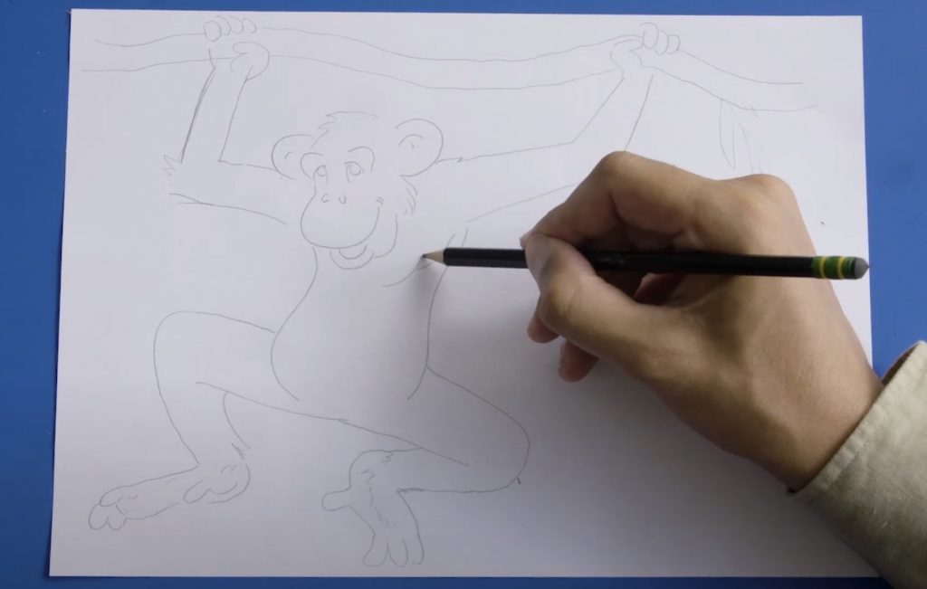Screengrab of a video, showing a hand holding a pencil in the process of drawing a chimp